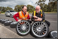 FCAI chief executive Tony Weber (left) and FCAI Delegate and Committee Chair David McCarthy with the broken fake wheel and undamaged genuine wheel after the pothole test.